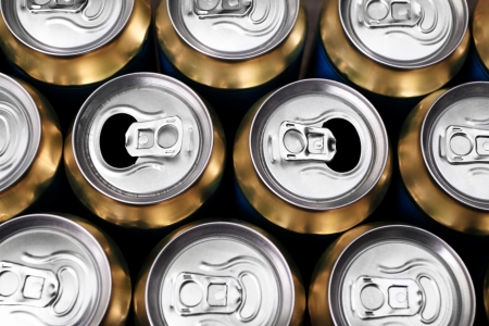Much of yellow drinking cans close up photo