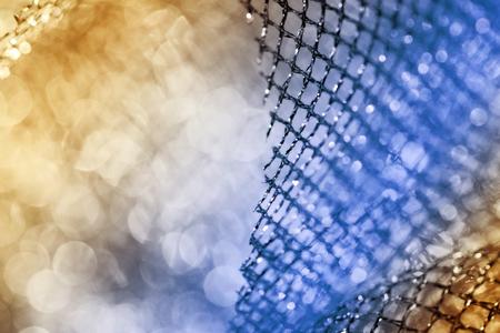 scintillating: lustrous elegant golden-blue fabric - macro