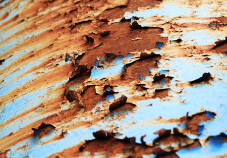 hole chipped paint rusty textured metal background photo