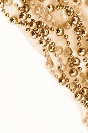 Close up of golden garland. Light background. photo