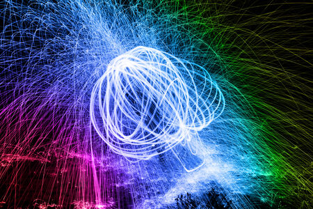 Showers of hot glowing sparks from spinning steel wool. Stock Photo - 26523056
