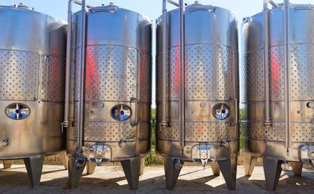 Modern aluminum barrels where grape juice is aged into wine photo