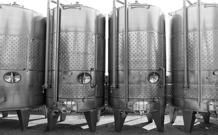 Modern aluminum barrels where grape juice is aged into wine photo