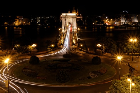 Public transport on the Suspension Bridge at night in Budapest photo