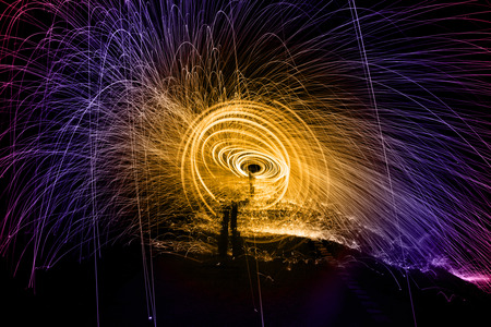 intresting: Showers of hot glowing sparks from spinning steel wool Stock Photo