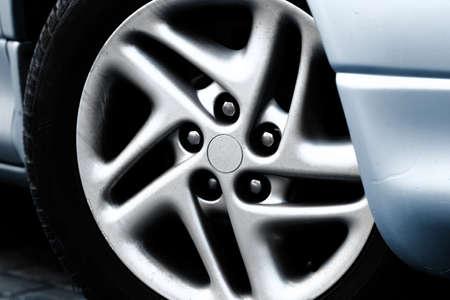 Close up photo of a silver car rimes photo