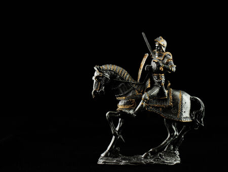 trooper: Silver statue of a trooper with black background Stock Photo