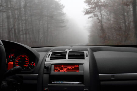 Photo of a dashboard in a foggy morning photo