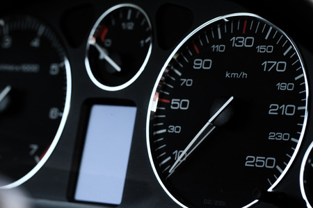 Close up photo of a balck speedometer photo