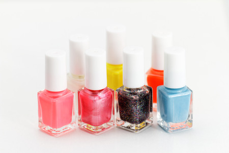 Photo of beautiful colorful nail polish with white background photo
