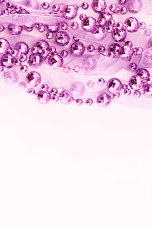 Close up of pink garland.  Light background. photo