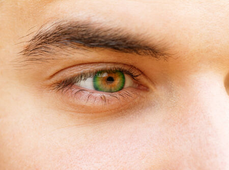 Close up photo of a beautiful young mans eyes photo