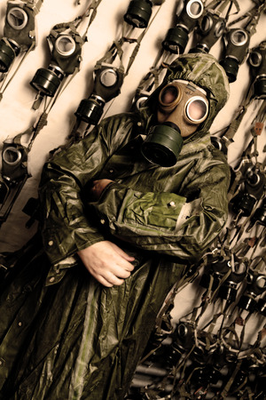 Photo of a man in WWIIs clothes and gas mask photo