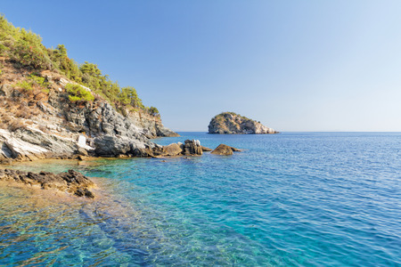 Photo of a beautiful green island and the beautiful sea photo