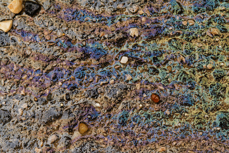 Photo of colorful oil spill on the road photo