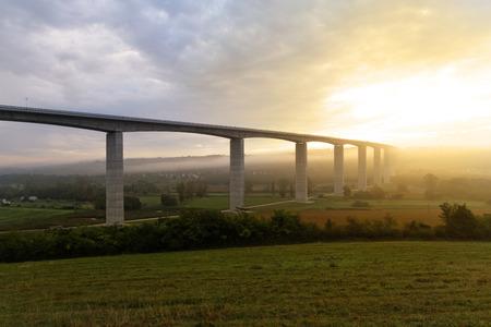 Large highway viaduct with foggy sunrise on autumn photo