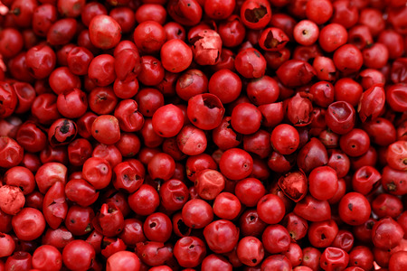 A background of pink peppercorns - macro photo photo