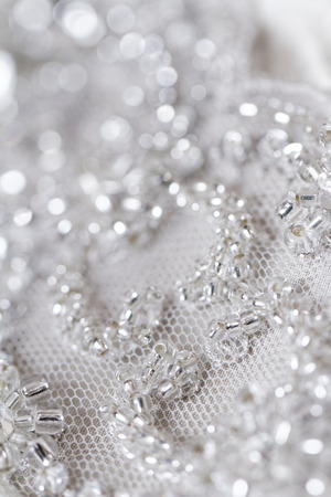 silver dress: Detail of wedding dress - macro photo