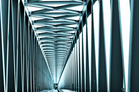 blue tone: Railway metal bridge perspective view - blue tone Stock Photo