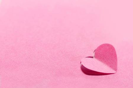 pink decorations: Pink paper hearts and pink background - macro photo Stock Photo
