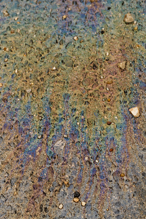 oil spill: Photo of colorful oil spill on the road Stock Photo