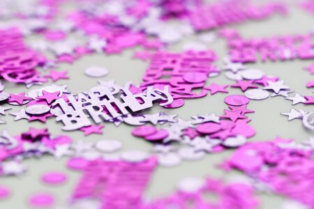 sissy: Pink happy birthday confetti pieces - macro photo