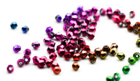 drilled: Beautiful glass beads closeup on white background Stock Photo