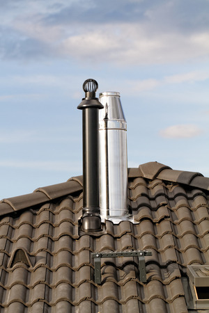 roofing system: Modern chimney on the roof of house