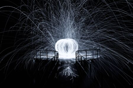 dazzling: Showers of hot glowing sparks from spinning steel wool Stock Photo