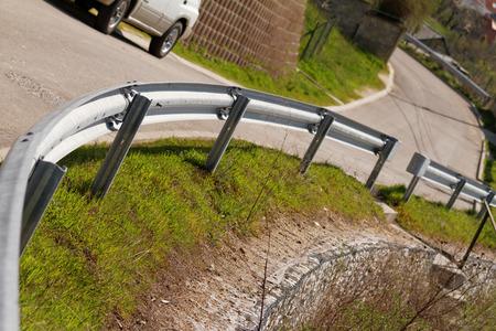 guard rail: Photo of a curvy roadand guard rail