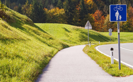 path: Photo of a bicycle path out of the city