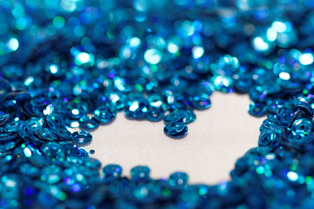 sequin: Close up photo lots of blue sequin