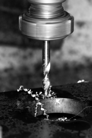 affixment: Close up photo of a CNC drilling Stock Photo