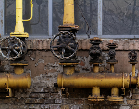 Closeup shot of big rusted valve industrial site