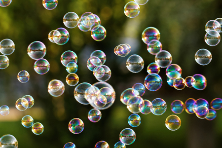 The rainbow bubbles from the bubble blower Stock Photo