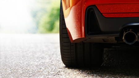 shiny car: Detail on hot red sport car wheels with sport breaks