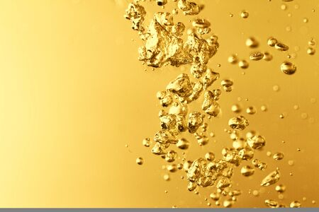 seltzer: Photo of the yellow water with bubbles