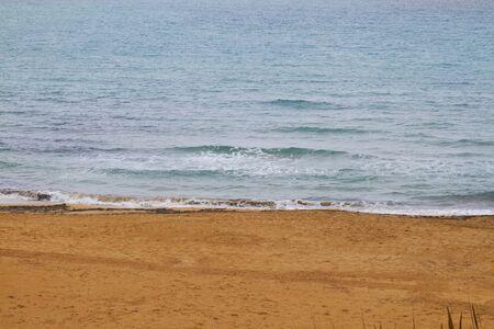 Photo of the sunny summer sandy beach. Greece - Malta