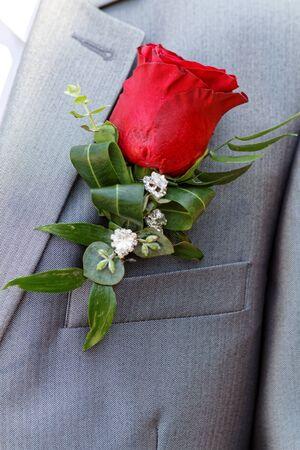 Wedding boutonniere on suit of groom - wedding flower