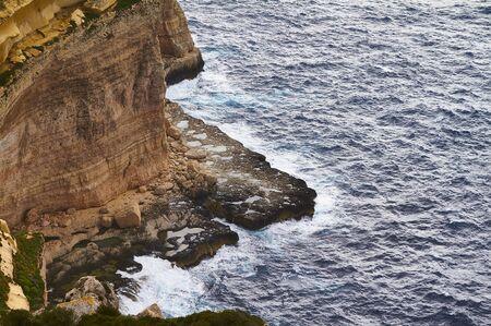 Huge waves crash on cloudy day. Greece -Kemmuna island