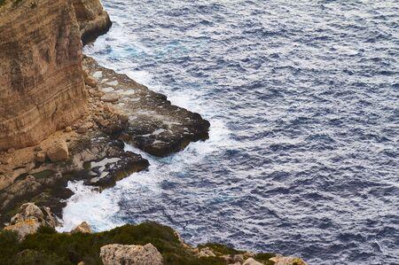 Huge waves crash on cloudy day. Kemmuna island Zdjęcie Seryjne