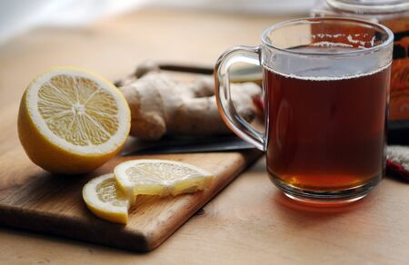 Tea with honey, a lemon and ginger Stock Photo - 18261757