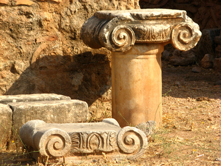 delphi: Two decorated with an ornamental wreck of columns stand on the ground under the open sky