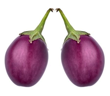 aubergine: Eggplants against a white background Stock Photo