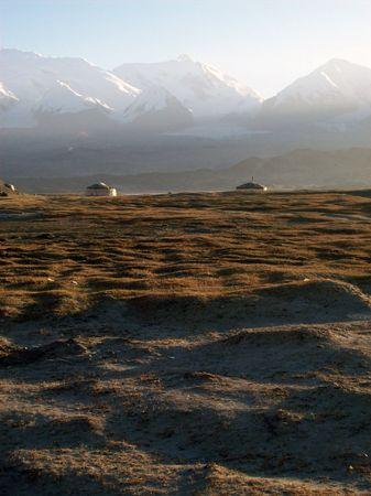 yurts in te morning sunlight