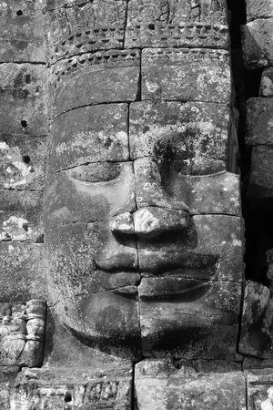 cambodia sculpture: face of Buddha smiling