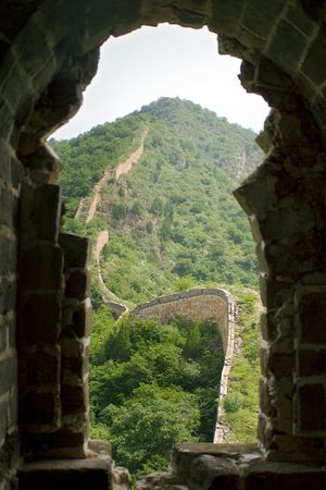 view of the great wall from the window of a watchtower