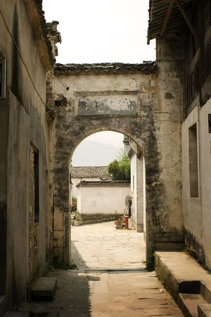 arched doorway in hongcun village, china photo