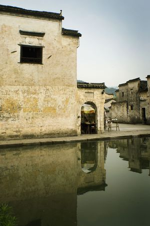houses reflected on water, hongcun village, china photo