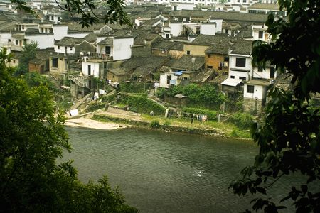 ancient village on a river in south china photo